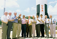 Konrad Dannenberg and colleagues in front of Saturn V rocket