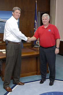 Kennedy Space Center Director William Parsons (left) shakes the hand of retiring director James Kennedy.