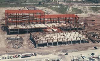 The Operations & Checkout Building takes shape in the industrial area of Kennedy Space Center