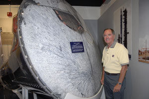 Astronaut Bob Crippen with a prototype Gemini capsule for the Air Force space program.