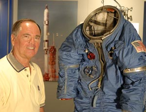 Astronaut Bob Crippen with a spacesuit recently found that was part of the Manned Orbiting Lab program.