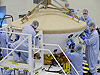 Scientists and technicians work on an interplanetary spacecraft