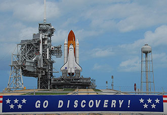Space Shuttle Discovery sits on launch pad 39-A