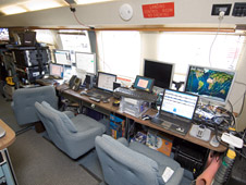 A view inside the Network Operations and Control Center Airstream.
