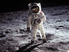 Astronaut Buzz Aldrin walks on the moon.
