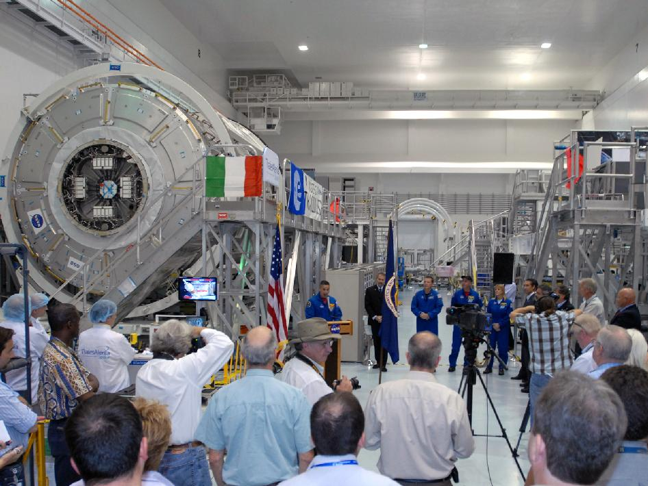 Members of the media gather inside the Space Station Processing high bay to see Tranquility Node 3.