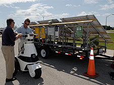 An electric scooter and its solar charging station.