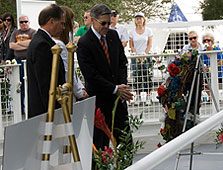 Bob Cabana, NASA Kennedy Space Center director, right, led a memorial service on the agency's Day of Remembrance