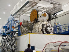 Technicians prepare to lift MRM-1 out of its transportation container