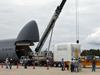 The Alpha Magnetic Spectrometer is unloaded from an Air Force C-5M aircraft
