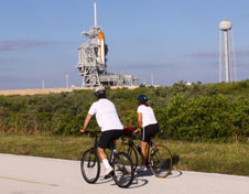 Cyclists go by Launch Pad 39A