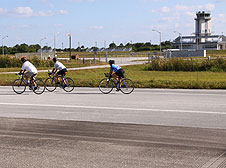 Cyclists ride up the Shuttle Landing Facility.