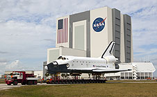 Shuttle model moves past Vehicle Assembly Building