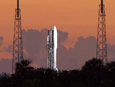 Clouds backdrop the Atlas V set to launch NASA's Juno spacecraft