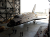 Shuttle Atlantis is towed into the Vehicle Assembly Building high bay 4