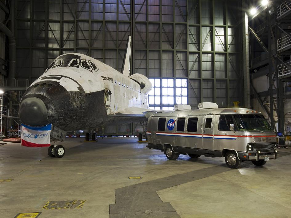 Space shuttle Discovery and the Astrovan on display.