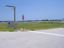 the sign at the entrance to Kennedy Space Center's Press Site parking lot