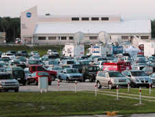 the NASA News Center as seen across the Kennedy Space Center Press Site parking lot