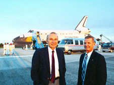 Launch Director Bob Sieck and Kennedy Space Center Director Forrest S. McCartney with space shuttle Atlantis