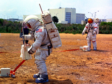 Apollo 15 astronauts training on Kennedy Space Center's simulated lunar surface