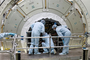 Workers attempt to open the Node 2 hatch