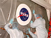 Technicians install NASA patch on U.S. Destiny lab