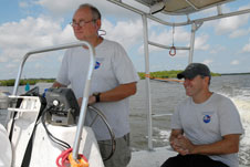Aquatic biologists Doug Scheidt and Eric Reyier take employees on a boat tour of Kennedy Space Center