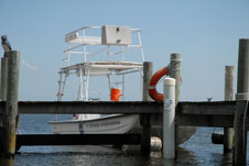 One of Kennedy Space Center's boats used for ecological research is docked in the Banana River