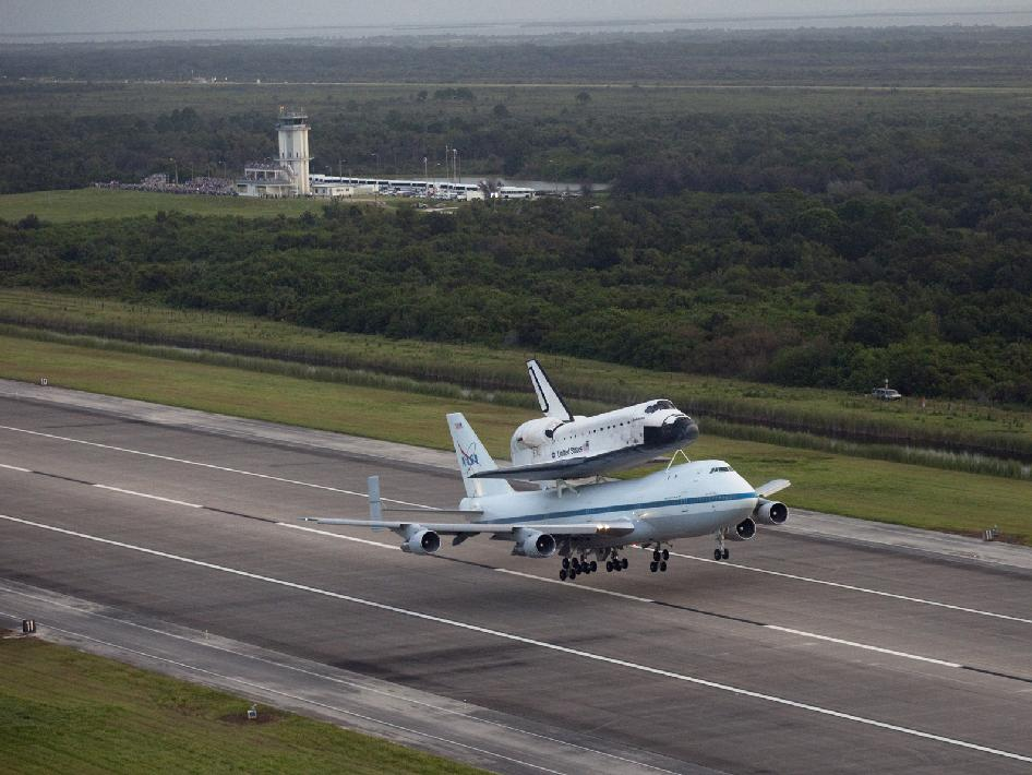Wheels up -- space shuttle Endeavour, secured to the Shuttle Carrier Aircraft, depart Kennedy Space Center