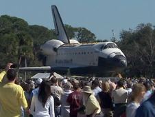 Space shuttle Atlantis moves through Exploration Park on the way to the Kennedy Space Center Visitor Complex