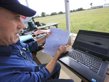 John Lane looks over data from testing.