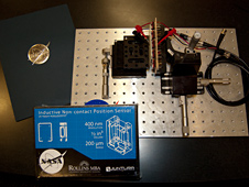 The original induction position sensor prototype and the prototype kit developed by Rollins team