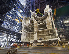Space shuttle-era work platforms are removed from high bay 3 in the Vehicle Assembly Building.