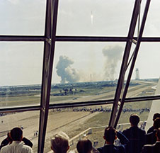 The launch of Apollo 11 as seen through the windows of the LCC firing room.