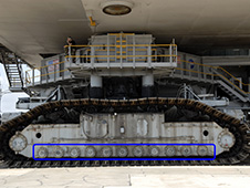 Recent work on crawler-transporter-2 includes preparations to install upgraded roller bearing assemblies, circled in blue in this image.