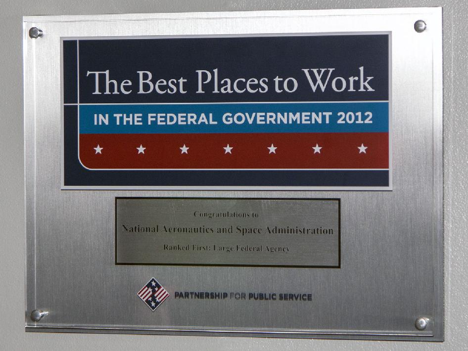 Wall plaque honoring NASA as best workplace.