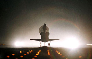 Atlantis silhouetted in runway lights