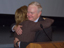Thumbnail of Lesa Roe and Roy D. Bridges hugging at Tuesday's all-hands meeting.