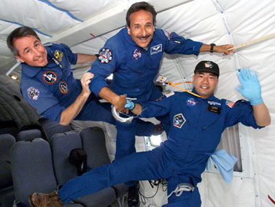 STS-114 astronauts Steve Robinson (left), Charlie Camarda (center) and Soichi Noguchi participate in Return to Flight training aboard NASA's KC-135 aircraft.