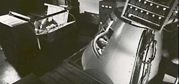 Original 7 astronaut John Glenn in Mercury Procedures Trainer