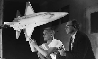 NASA engineer and technician work with an X-15 wind tunnel model