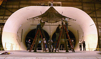 Technicians install a Blended Wing Body prototype in NASA Langley's Full-Scale Tunnel