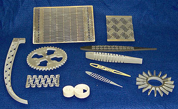 A display of cut pieces from the Systems Engineering Directorate's Water Jet cutters.