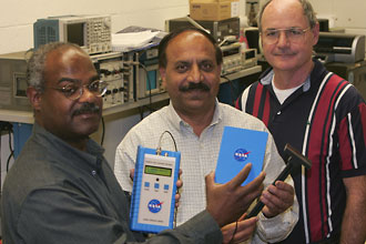 The team of Stanley E. Woodard, Qamar Shams, Bryant D. Taylor (L to R) and the late Robert Fox (not pictured) won an R&D 100 Award for a wireless sensor system that doesn't need a battery or a receiver