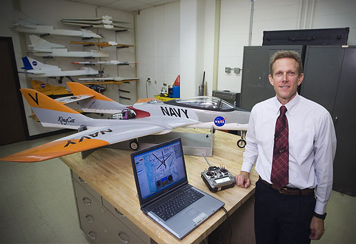 Dr. Mark A. Motter stands beside the NASA Jet-FLying Controls testbed (J-FLiC)