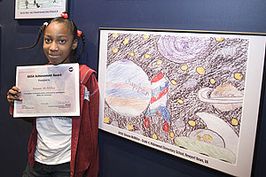 4th grader Simone McMillon presents her award-winning artwork