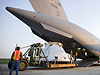 Orion crew module simulator loading onto C-17 for transport to NASA Dryden
