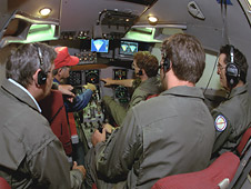 NASA researchers evaluating wind shear sensor displays in the experimental flight deck at NASA's Boeing 737 research aircraft.