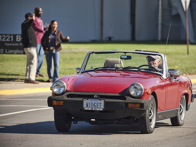 Keith Henry driving his MG Midget.