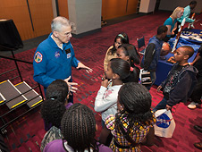 NASA astronaut Lee Morin speaks to students at Education Day
